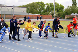 Young children with disabilities taking part in Mini games sports event held at Stoke Mandeville Stadium,