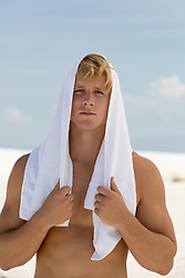 All American man with a white towel over his head outdoors