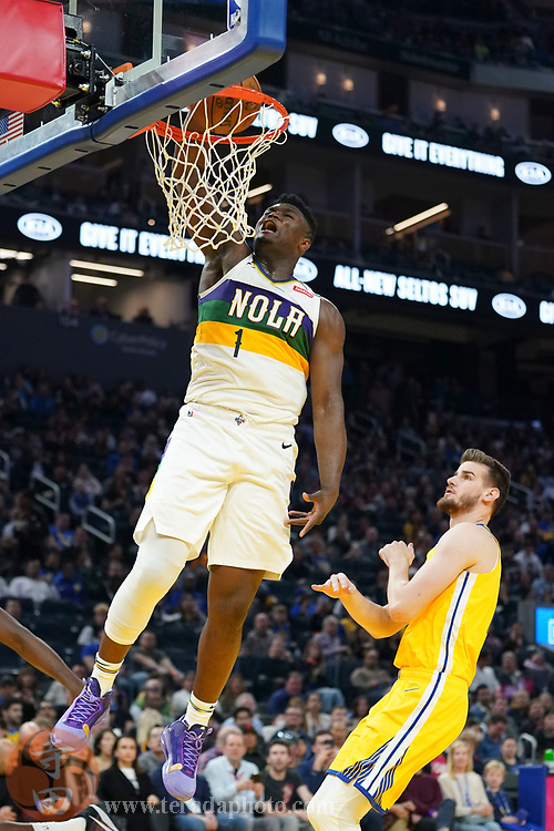 February 23, 2020; San Francisco, California, USA; New Orleans Pelicans forward Zion Williamson (1) dunks the basketball against Golden State Warriors center Dragan Bender (10) during the third quarter at Chase Center.