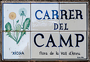 Ceramic street sign, Esterri d'Aneu, Pyrenees mountains, Catalonia, Spain.