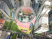 Aerial view of a park in the heart of a modern building surrounded by skyscrapers in Singapore.