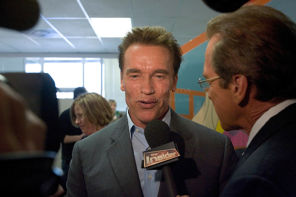 NORTH HOLLYWOOD, CA -  JANUARY 9:  With 15 stitches in his upper lip as a result of  a weekend motorcycle accident California Governor Arnold Schwarzenegger speaks to reporters as he visits the Northeast Valley Health Corp. Woman, Infant, Child Center on January 9, 2006 in North Hollywood, California. The governor was riding his Harley Davidson motorcycle on Sunday January 8 with his 12 year old son Patrick in a side-car when he collided with a car that pulled out into the street in front of him. His son escaped injury. At the center, Governor Schwarzenegger spoke about health insurance for children and announced a $72.2 million budget proposal to maximize enrollment of eligible children in the Med-Cal and Healthy Families programs. Photograph by David Paul Morris