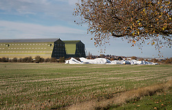 © Licensed to London News Pictures. 19/11/2017. Bedford, UK. The remains of the Airlander 10 airship are seen in a field near Cardington air sheds. The world's longest aircraft has collapsed to the ground after breaking free from it's mooring.  A safety mechanism deflated the aircraft automatically. Two people on the ground suffered minor injuries.Photo credit: Peter Macdiarmid/LNP