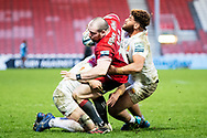 Fraser Balmain of Gloucester Rugby is tackled by Rusiate Tuima of Exeter Chiefs during the Gallagher Premiership Rugby match between Gloucester Rugby and Exeter Chiefs at the Kingsholm Stadium, Gloucester, United Kingdom on 26 March 2021.