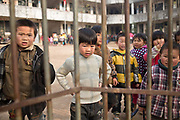 Children play during recess at an elementary school at a rural village in Shangrao, Jiangxi Province, China on 12 December 2012.   The villages near the city of Shangrao are known for openly defying China's one child policy as most families have more than one child.