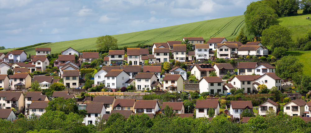 Little boxes - neat housing estate of almost identical detached town houses in coastal town of Teignmouth in Devon, UK