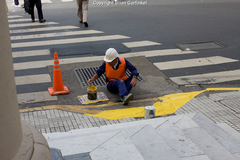 Buenos Aires, Argentina - A City worker paints a crosswalk