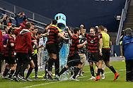 13 December 2015: Stanford players dump a cooler of PowerAde on head coach Jeremy Gunn as the game ends. The Clemson University Tigers played the Stanford University Cardinal at Sporting Park in Kansas City, Kansas in the 2015 NCAA Division I Men's College Cup championship match. Stanford won the game 4-0.
