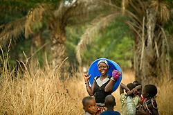 Swema Kabliya walks to get water in the  village of Nkonkwa, on Lake Tanganyika in Tanzania.