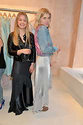 Left to right, PHOEBE SALTER and HANNAH SCOTT at a party to celebrate the re-launch of the Ghost Flagship store at 120 King's Road, London on 15th April 2015.