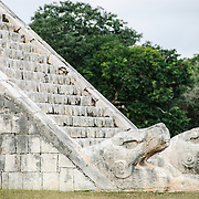 Bottom of the stairs of Temple of Kukulkan (El Castillo) at Chichen Itza Archeological Zone, ruins of a major Maya civilization city in the heart of Mexico's Yucatan Peninsula.