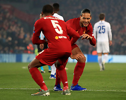 Liverpool's Georginio Wijnaldum (left) celebrates scoring his side's first goal of the game with team-mate Virgil van Dijk during the UEFA Champions League match at Anfield, Liverpool.