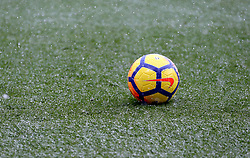 A ball sits on the pitch during the pre-match warm up
