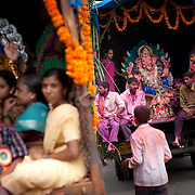 family member transport their decorated idols of lord Ganesh on trucks for immersion in the Indian ocean on the last day of the Ganesh Chaturthi festival. Ganesh, the elephant-headed son of Shiva and Parvati is widely worshiped as the supreme God of wisdom, prosperity and good fortune. Mumbai, September 2009.