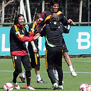 Galatasaray's players Emre GUNGOR (L) Gokhan ZAN (C) during their training session at the Jupp Derwall training center, Tuesday, April 20, 2010. Photo by TURKPIX