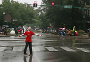 Colin Freeman-Day sings and dances in the rain at Walnut and Kirkwood before the 4th of July Parade. (Photo by Jeremy Hogan)