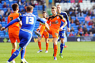 Ipswich's Luke Hyam (c) controls the ball watched by Cardiff City's Lex Immers (27). Skybet football league championship match, Cardiff city v Ipswich Town at the Cardiff city stadium in Cardiff, South Wales on Saturday 12th March 2016.<br /> pic by Carl Robertson, Andrew Orchard sports photography.