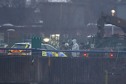 © Licensed to London News Pictures. 09/03/2018. Salisbury, UK. A military crane lifts a police car from the Accident and Emergency entrance of Salisbury District hospital. Former Russian spy Sergei Skripal and his daughter Yulia are critically ill after being poisoned with nerve agent. The couple where found unconscious on bench in Salisbury shopping centre. A policeman who went to their aid is recovering in hospital. Photo credit: Peter Macdiarmid/LNP