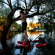 Jaime Vasquez, 7, stands on his broken motorized toy jeep as Hurricane Dolly floodwater fills his yard on Catherine Street south of Edcouch. Jaime, his four siblings and his parents have been staying in their flooded home despite having no food, little water and all their personal belongings destroyed in the storm. <br /> Nathan Lambrecht/The Monitor