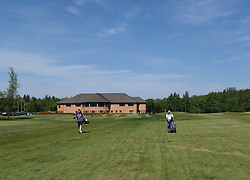 Scottish Golfers Back On The Course, Pumpherston, 29 May 2020<br /> <br /> Golf was one of the activities that were eased during phase one of lockdown restrictions in Scotland today, as long as social distancing rules were observed.<br /> <br /> Golfers at Pumpherston Golf Club in West Lothian were quick to take  advantage of the new rules.<br /> <br /> Pictured: Club members Derek Carruthers and Stuart Gowans.<br /> <br /> Alex Todd | Edinburgh Elite Media