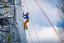 Dutch Ice Climbing Team athlete Dennis van Hoek in action. The ice is being sprayed against an old high-voltage pylon that NUON donated years ago to the climbing center near the Rijnhal. Making such an ice wall of 15 meters high, the highest ever in the Netherlands, requires a lot of patience and attention, but it really comes about drop by drop. Mountain climbers train on a vertical ice wall made in an electricity mast on february 12, 2021 in Arnhem