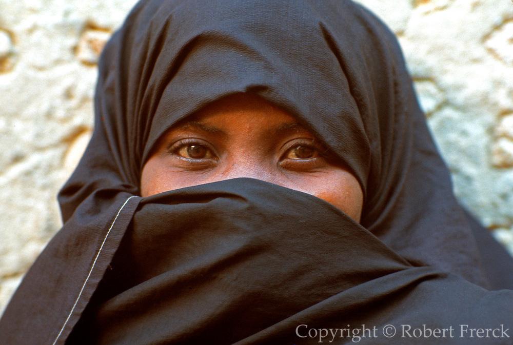 KENYA, LAMU ISLAND veiled Swahili girl in town on Lamu Island