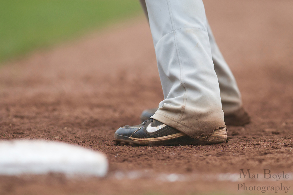 A pair of Nike cleats at first base.  Rowan University Baseball hosts Ramapo College in the 2nd round of the NJAC tournament on Thursday May 3, 2012 in Glassboro, NJ. (photo / Mat Boyle)