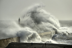 January 3, 2018 - City, COUNTY/STATE, COUNTRY - Newhaven, UK.  People watch huge waves crash against Newhaven Breakwater, East Sussex, as Storm Eleanor passes. (Credit Image: © Peter Cripps/London News Pictures via ZUMA Wire)