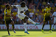 Bafetimbi Gomis of Swansea City takes a shot at goal. Barclays Premier League, Watford v Swansea city at Vicarage Road in London on Saturday 12th September 2015.<br /> pic by John Patrick Fletcher, Andrew Orchard sports photography.