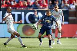 July 28, 2018 - Ann Arbor, Michigan, United States - Fabinho (3) of Liverpool and Alexi Sanchez (7) of Manchester fight for possession of the ball during an International Champions Cup match between Manchester United and Liverpool at Michigan Stadium in Ann Arbor, Michigan USA, on Wednesday, July 28,  2018. (Credit Image: © Amy Lemus/NurPhoto via ZUMA Press)