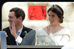 Newlywed Princess Eugenie of York waves to the crowd from her carriage after her Royal wedding to Mr. Jack Brooksbank at St. George's Chapel in Windsor, England on October 12, 2018. Photo by Aurore Marechal/ABACAPRESS.COM