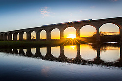 © Licensed to London News Pictures. 28/11/2017. Arthington UK. A commuter train crosses Arthington viaduct at sunrise this morning on a bright but cold morning in Yorkshire. Photo credit: Andrew McCaren/LNP