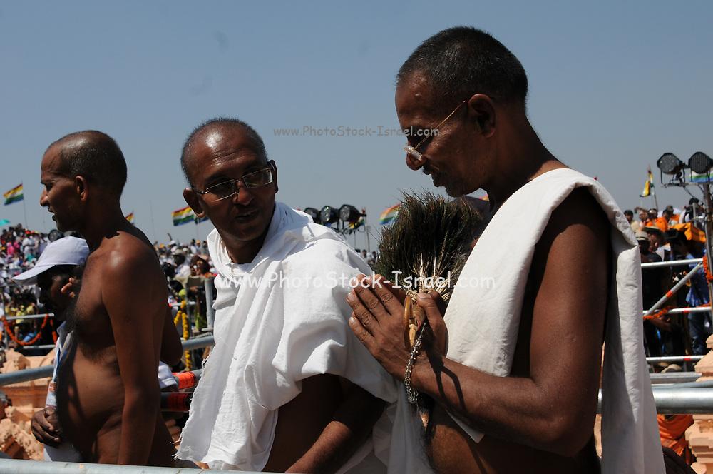 Jain devotees at the foot of gomateshvara bahubali statue, Shravanbelagola, Hassan, Karnataka, India