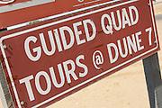 Tourist information sign in the Namib Desert, near Walvis Bay, Namibia