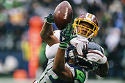 Washington cornerback Josh Thomas breaks up a pass intended for Seahawks wide receiver Jeremy Lane, during the first half of their game, Sunday, Nov. 5, 2017 at CenturyLink Field. (Genna Martin, seattlepi.com)