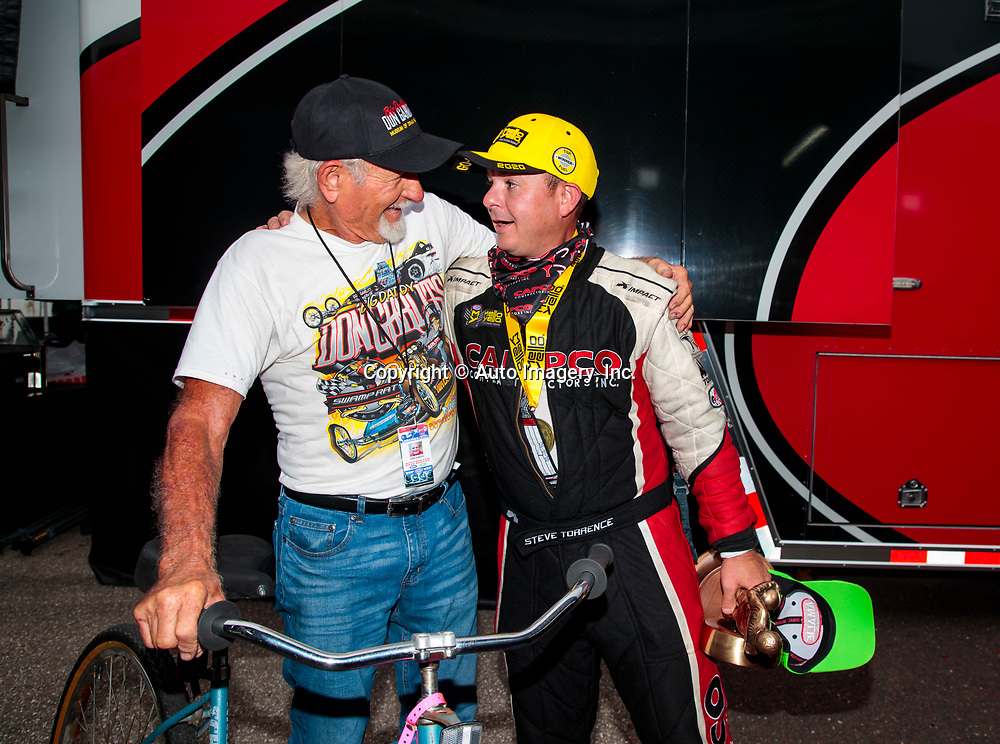 Sep 27, 2020; Gainesville, Florida, USA; NHRA top fuel driver Steve Torrence (right) celebrates with Don Garlits after winning the Gatornationals at Gainesville Raceway. Mandatory Credit: Mark J. Rebilas-USA TODAY Sports2020 NHRA, Gatornationals