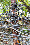 A tangle of illegal electricity cables in the Munika area. New Delhi, India