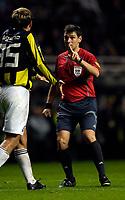 Photo: Jed Wee.<br /> Newcastle United v Fenerbahce. UEFA Cup. 19/10/2006.<br /> <br /> Polish referee Grzegorz Gilewski (R) admonishes Fenerbahce's Diego Lugano.