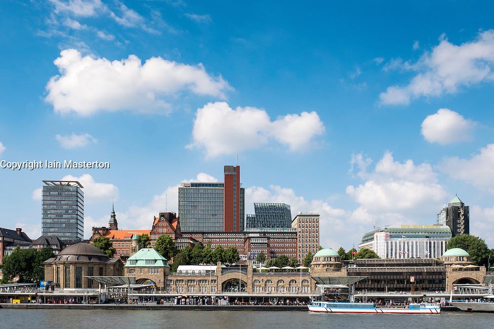 View of boat landing jetties, Landungsbrucken, and skyline of city at St Pauli in port of Hamburg Germany