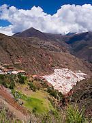 High-angle view of Salinas de Maras (Maras Saltworks), near Cusco, Peru, with Mount Veronica in the background.