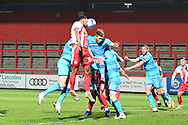 Stevenage defender Terence Vancooten(15)  heads the ballduring the EFL Sky Bet League 2 match between Stevenage and Cheltenham Town at the Lamex Stadium, Stevenage, England on 20 April 2021.