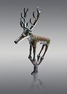 Bronze Age Hattian ceremonial deer statuette in bronze from a possible Bronze Age Royal grave (2500 BC to 2250 BC) - Alacahoyuk - Museum of Anatolian Civilisations, Ankara, Turkey. Against a gray background .<br /> <br /> If you prefer to buy from our ALAMY PHOTO LIBRARY  Collection visit : https://www.alamy.com/portfolio/paul-williams-funkystock/royal-tombs-alaca-hoyuk-bronze-age.html (TIP refine search by adding background colour in the LOWER search box)<br /> <br /> Visit our ANCIENT WORLD PHOTO COLLECTIONS for more photos to download or buy as wall art prints https://funkystock.photoshelter.com/gallery-collection/Ancient-World-Art-Antiquities-Historic-Sites-Pictures-Images-of/C00006u26yqSkDOM