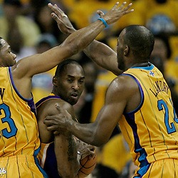 April 22, 2011; New Orleans, LA, USA; Los Angeles Lakers shooting guard Kobe Bryant (24) is defended by New Orleans Hornets shooting guard Willie Green (33) and power forward Carl Landry (24) during the second quarter in game three of the first round of the 2011 NBA playoffs at the New Orleans Arena.    Mandatory Credit: Derick E. Hingle