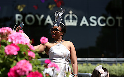 A racegoer takes a selfie on day three of Royal Ascot at Ascot Racecourse.