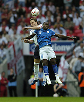 Photo: Jonathan Butler.<br /> England v Israel. UEFA European Championships Qualifying. 08/09/2007.<br /> John Terry of England jumps for the ball with TotoTamuz of Israel.