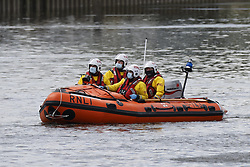 © Licensed to London News Pictures. 10/05/2021. London, UK. An RNLI crew looks for a young minke whale seen in the River Thames in south west London. Fire crews and the British Divers Marine Life group worked with an Rescue Royal National Lifeboat Institute (RNLI) crew in an effort to save the whale after it got stuck last night. But it is now free . Photo credit: Peter Macdiarmid/LNP