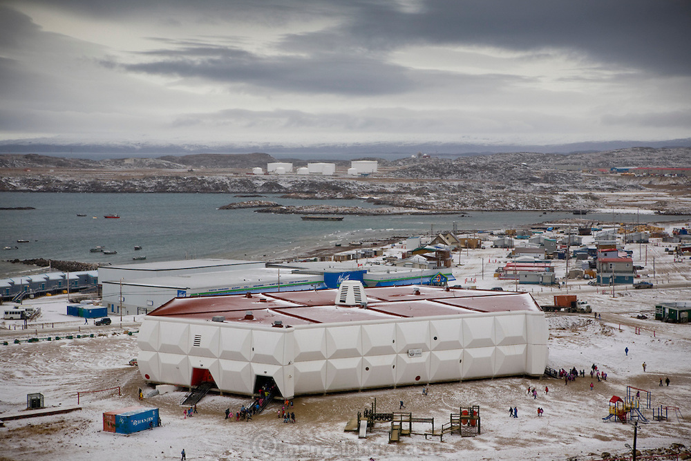 "The town of Iqaluit in Nunavut territory, Canada. With a population of 6,000 Iqaluit is the largest community in Nunavut as well as the capital city. It is located in the southeast part of Baffin Island, Canada. Formerly known as Frobisher Bay, it is at the mouth of the bay of that name, overlooking Koojesse Inlet. ""Iqaluit"" means 'place of many fish'."