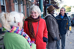 Group of older people waiting at a bus stop,