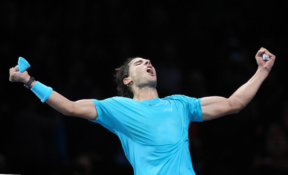 Rafael Nadal (ESP) celebrates his victory over Stanislas Wawrinka (SWZ) in their Group A match today - Rafael Nadal (ESP) def Stanislas Wawrinka (SWZ) 7-6[5] 7-6[6]<br /> <br /> Photo by Kieran Galvin/CameraSport<br /> <br /> International Tennis - Barclays ATP World Tour Finals - O2 Arena - London - Day 3 -  Wednesday 6th November 2013<br /> <br /> © CameraSport - 43 Linden Ave. Countesthorpe. Leicester. England. LE8 5PG - Tel: +44 (0) 116 277 4147 - admin@camerasport.com - www.camerasport.com