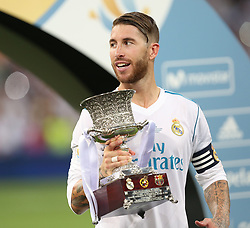 August 17, 2017 - Madrid, Spain - Sergio Ramos of Real Madrid celebrates with the trophy after the Supercopa de Espana Final second leg match between Real Madrid and FC Barcelona at Estadio Santiago Bernabeu on August 16, 2017 in Madrid, Spain. (Credit Image: © Raddad Jebarah/NurPhoto via ZUMA Press)